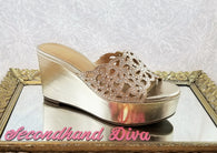Thalia Sodi gold mule wedges