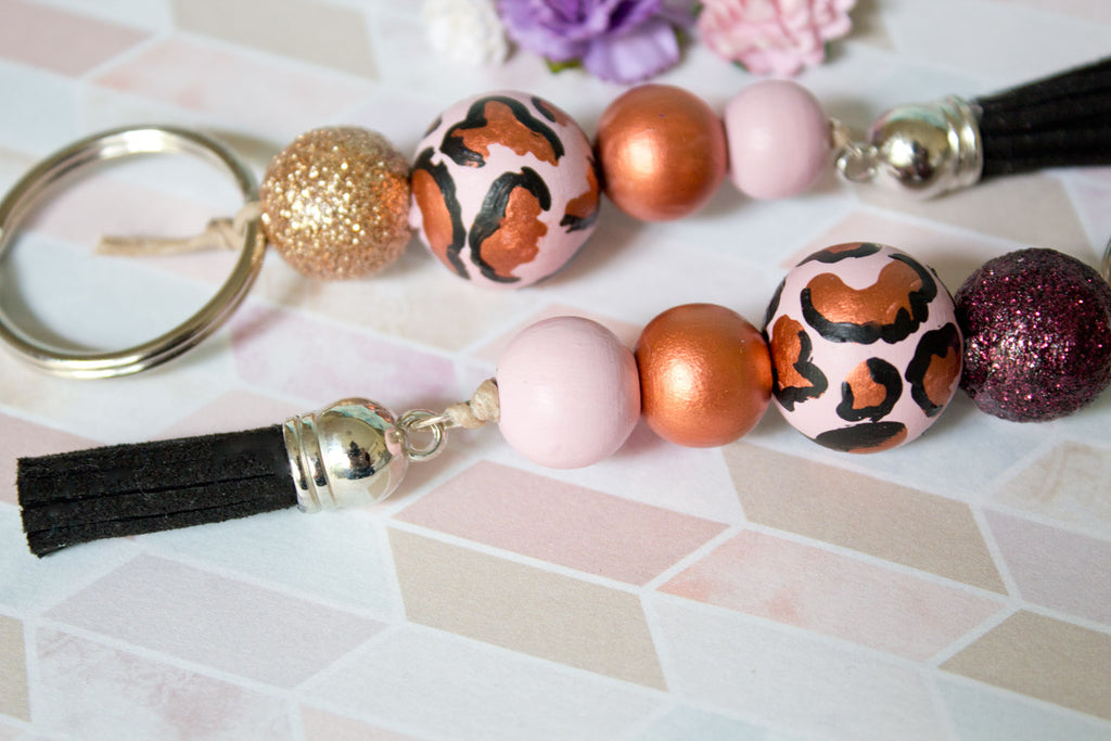 ... Leopard - Women s Rose Gold Handpainted Wooden Bead Tassel Keyring -  Violets and Poppies Handmade Wooden 05dc7c0c66