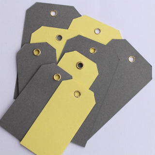 10 Dark Grey Eyelet Tags (small)