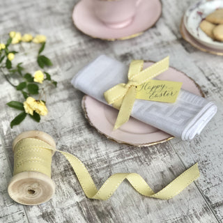 yellow stitched ribbon roll