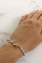 Handwriting and aquamarine bracelet