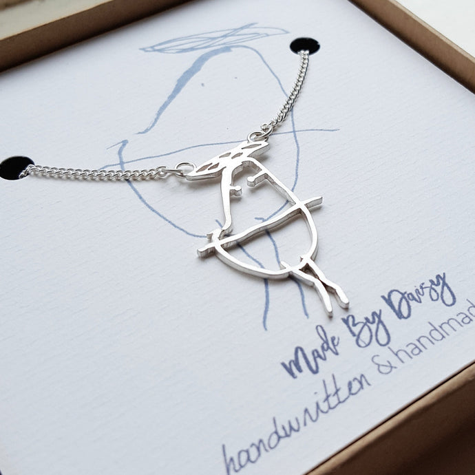 Your childrens drawing necklace handmade in the UK