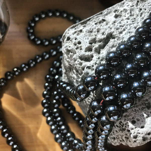 Hematite provides a protective grounding energy that evokes deep memory & thought. With all the traveling & work we do, it's comforting to keep this gem around us for extra stability.