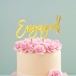 Gold Engaged Cake Topper on a cake - Create That Cake
