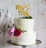 Mr & Mrs Gold Cake Topper on a cake - Create That Cake
