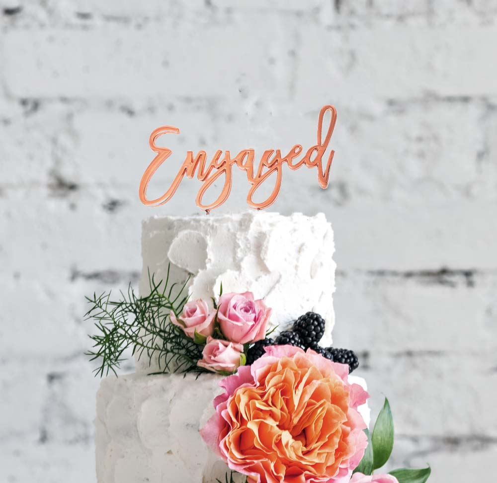 Engaged Rose Gold Cake Topper on a cake - Create That Cake