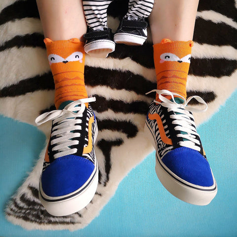 A Girl Wearing Fox Socks and Vans Trainers