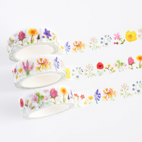 A photograph of white washi with watercolour flowers.