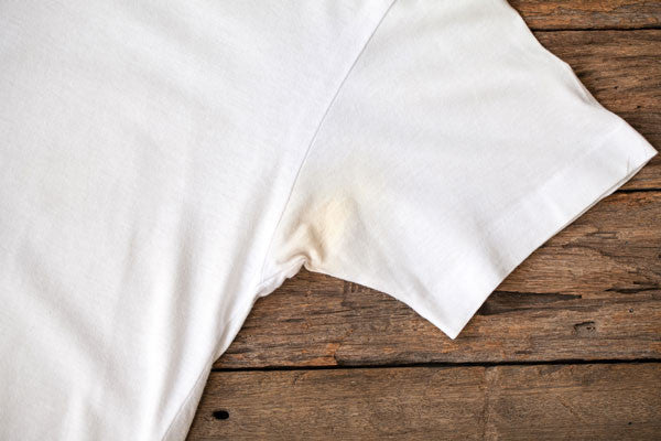 White t-shirt with yellow armpit stains