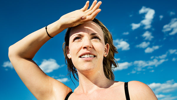 women sweating with blue sky