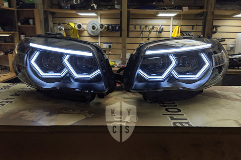 "Headlight options on the above vehicle: BavGruppe Design (white) angel eyes | Modern blackout | Bi-LED 2.5"" projector with LED bulb 