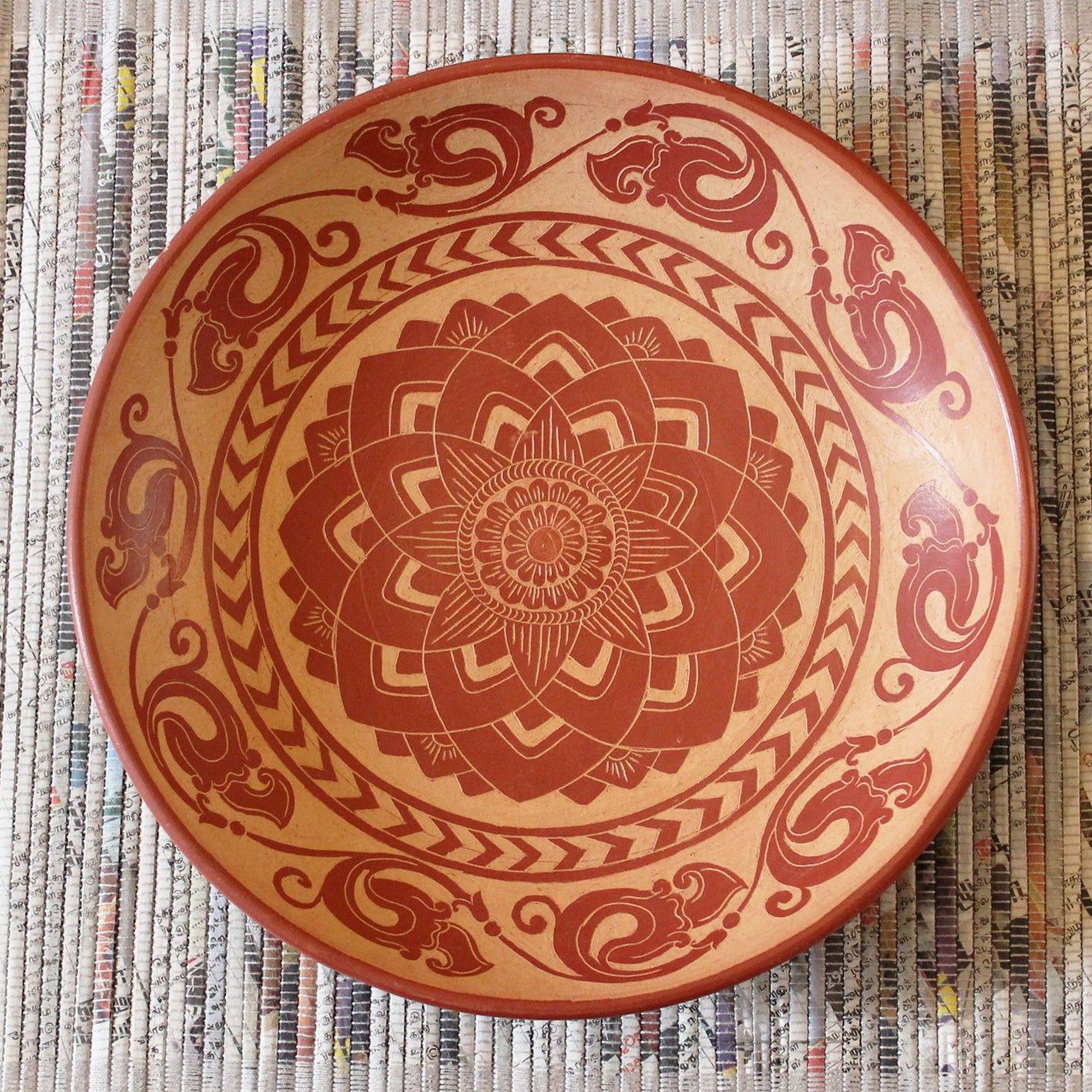 Terracotta pottery plate with hand-etched design
