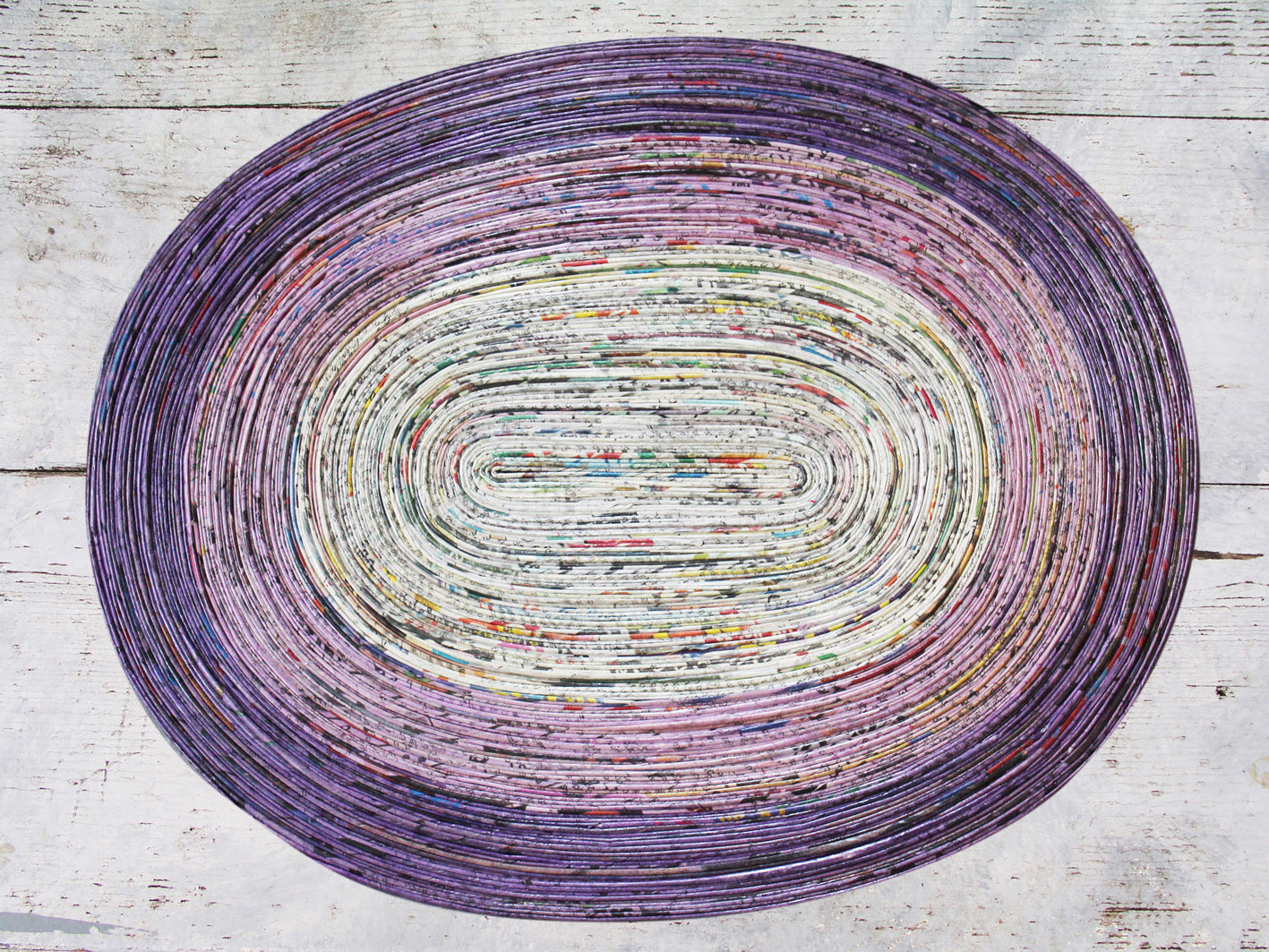 Newspaper table mat - oval, 8 colours