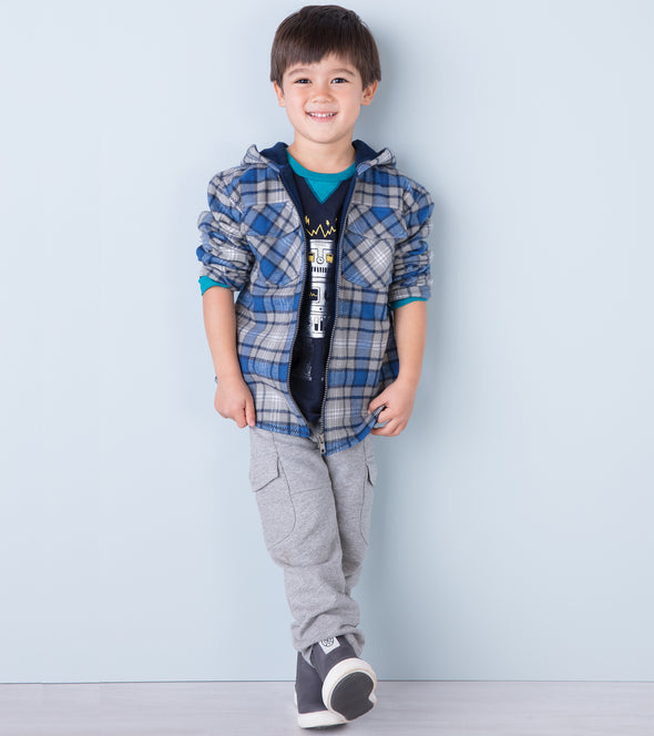 Gradeschool age boy wearing a hooded blue and gray plaid jacket by Hatley.