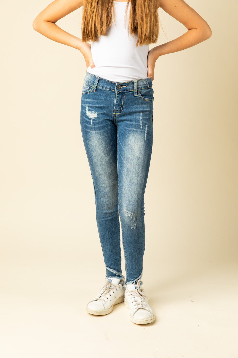 DISTRESSED ANGLE HEM DENIM JEANS