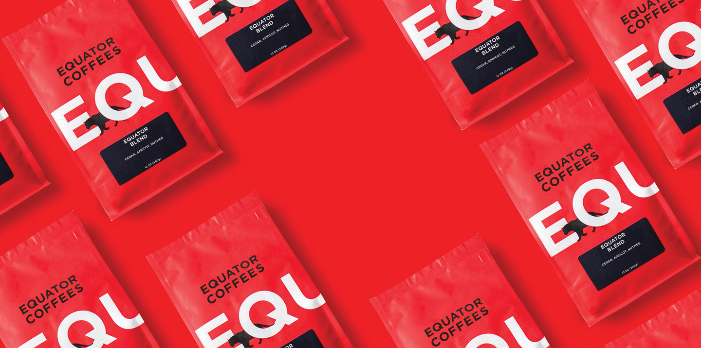 Equator Coffees bags laying on a flat surface