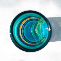 Aqua banded cylinder from above