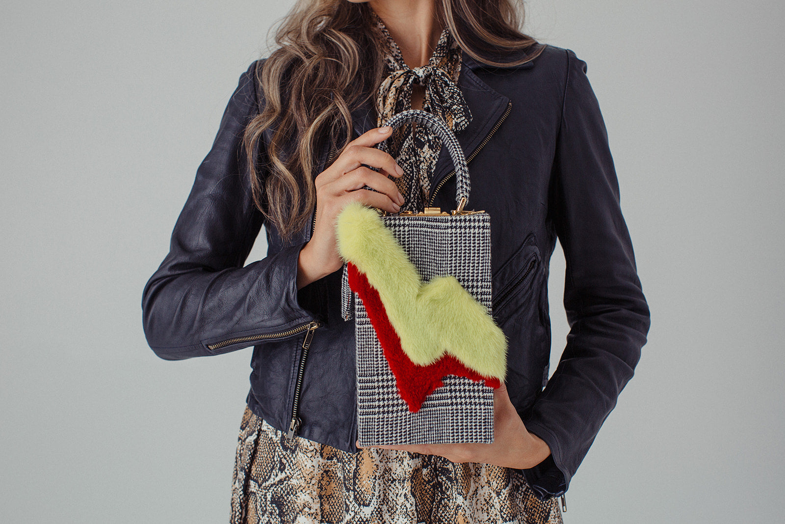 Her Houndstooth and Mink Handbag