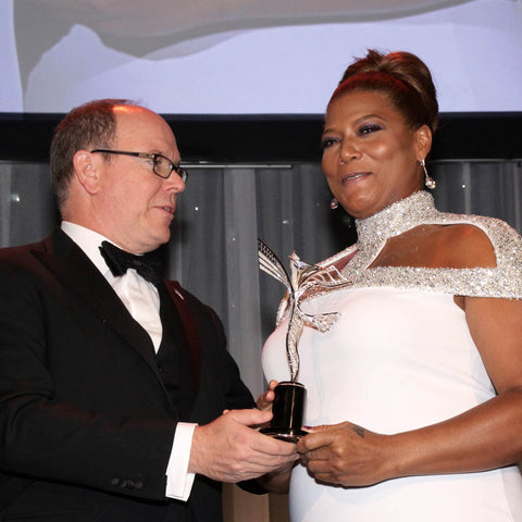 HSH Prince Albert II of Monaco presenting Queen Latifah with Princess Grace Award, designed and created by Alex Soldier.