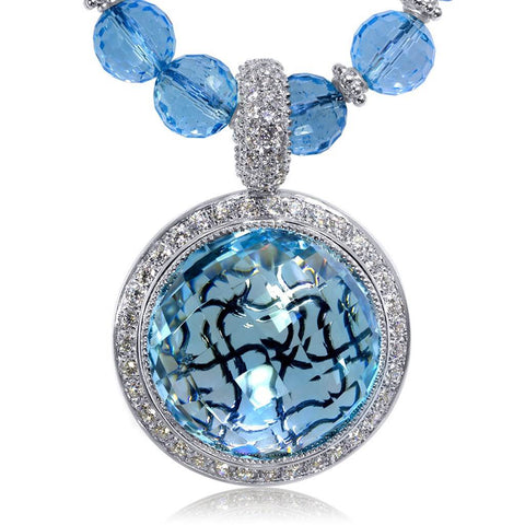 BLUE TOPAZ AND DIAMONDS GOLD SYMBOLICA PENDANT