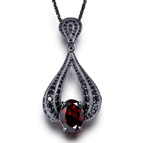 BLACKENED GOLD TWIST PENDANT WITH GARNET AND BLACK SPINEL