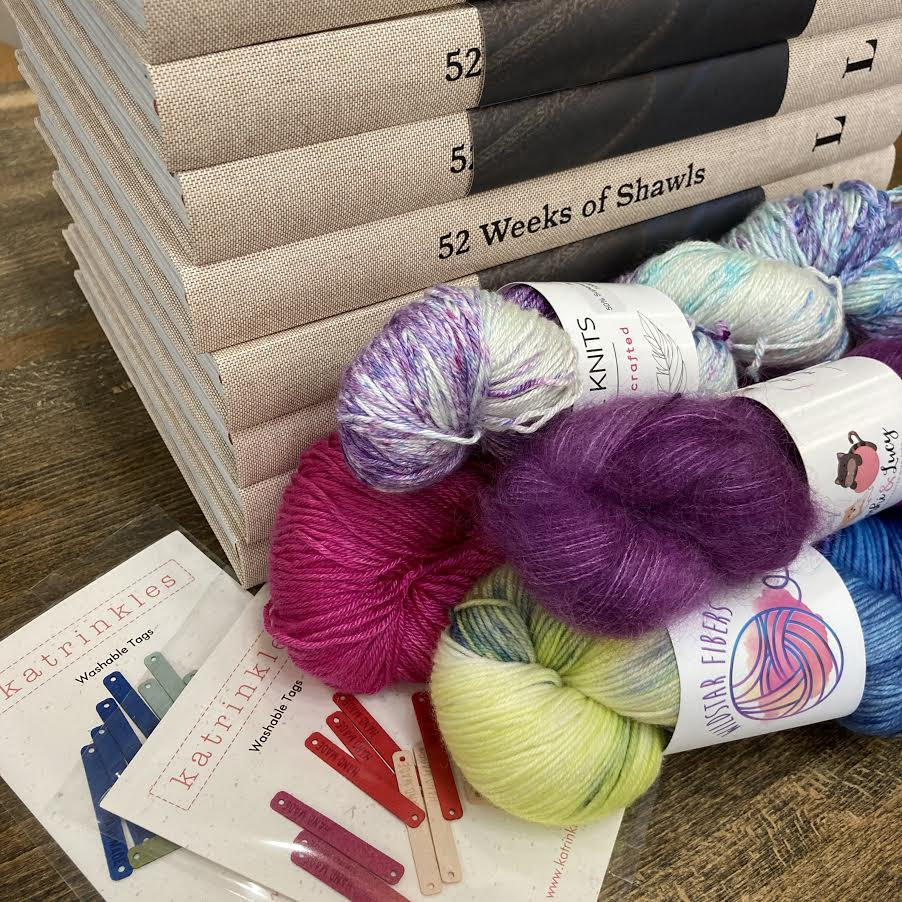 skeins of yarn and books