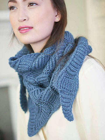 woman wearing blue handknit triangular shawl around her neck