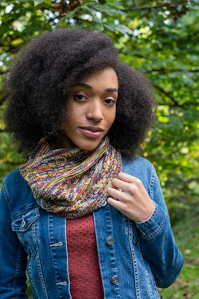 woman outside wearing denim jacket and multi-color knit cowl