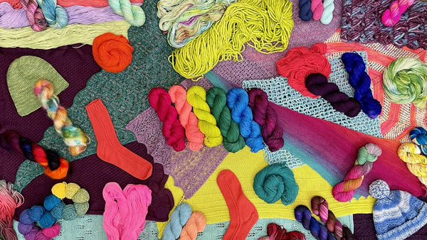 rainbow skeins of yarn and projects