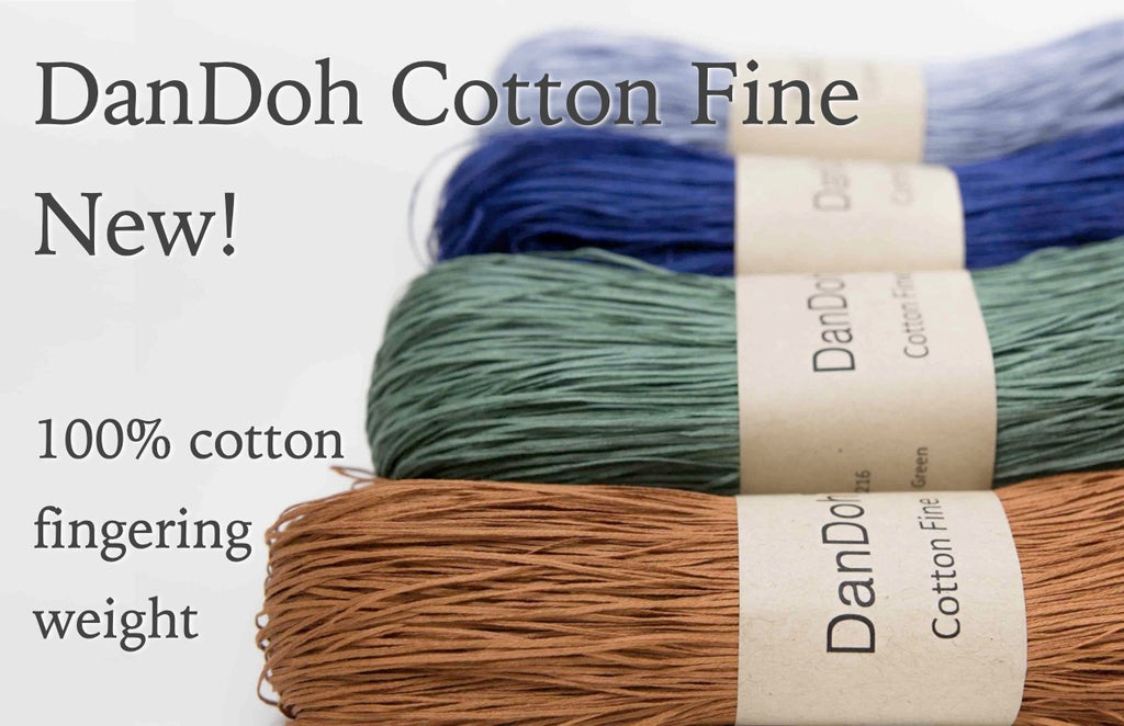 mustard, teal, navy, and lightblue skeins of fine cotton tape yarn in kraft paper wrappers on a white background with text overlay: DanDoh Cotton Fine New! 100% cotton, fingering weight