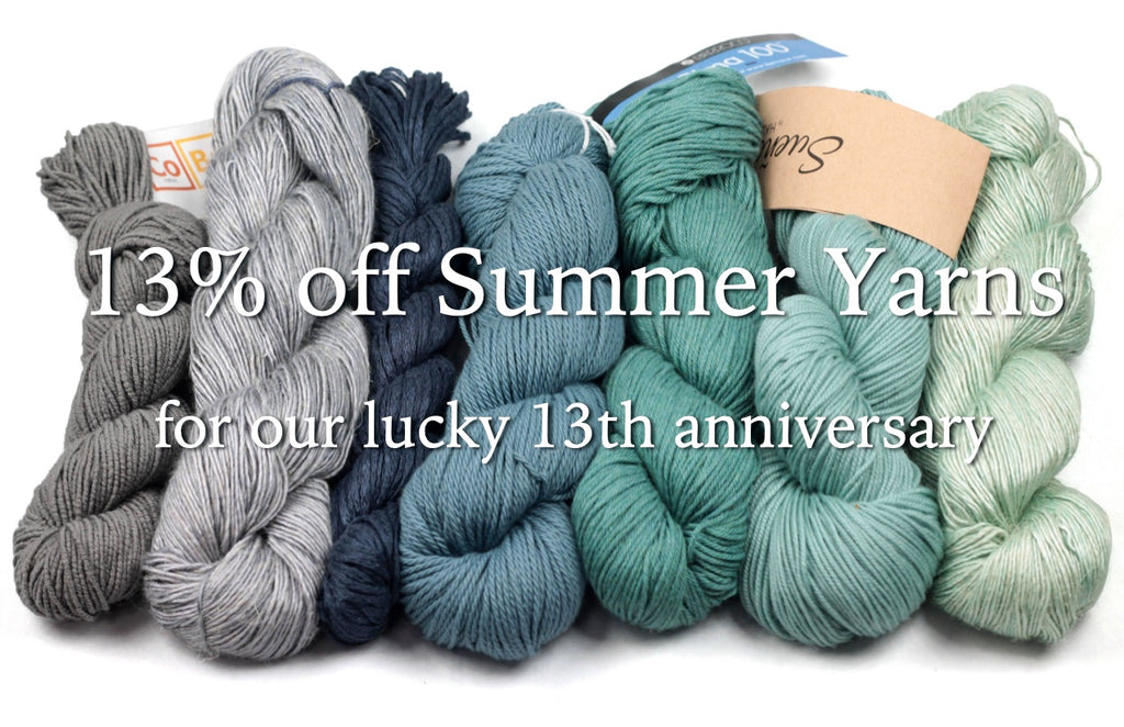assorted teal and gray skeins of cotton, linen, and bamboo yarns with text overlay: 13% off summer yarns for our 13th anniverary