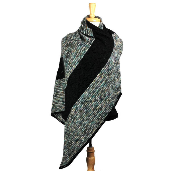 black and speckled gray hand knit shawl on dress form