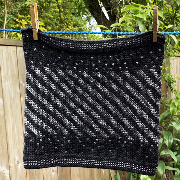 close up of gray and black cowl