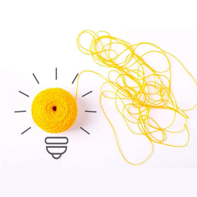 Ball of yellow yarn illustrated to look like a lightbulb