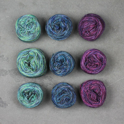 Shifting Shadows Yarn Winding - three colors of yarn wound into three balls each - Twisted Yarn Shop