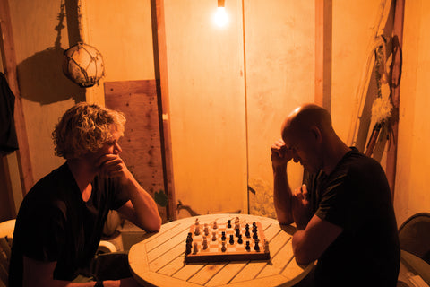 John John Florence and Kelly Slater playing chess