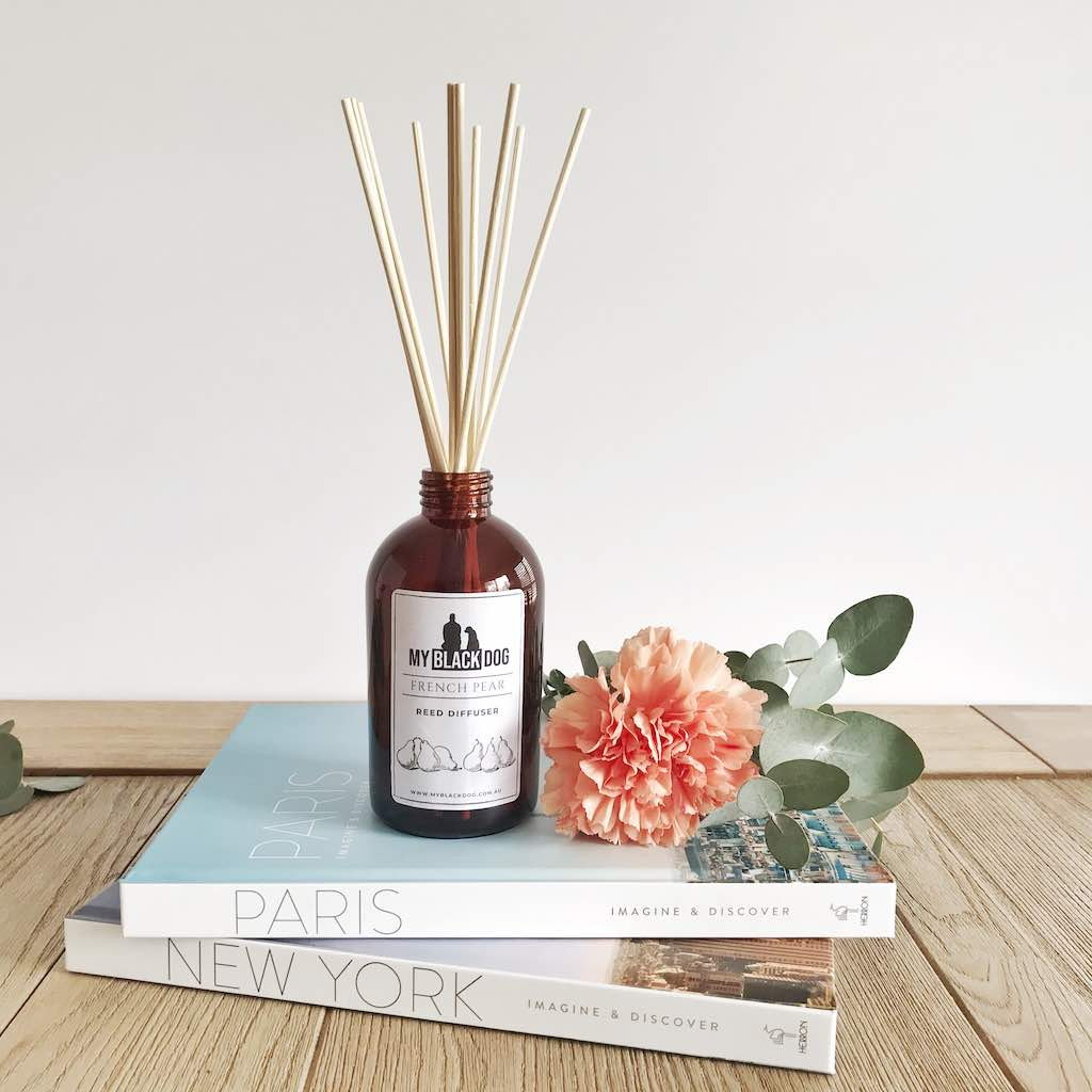 My Black Dog Reed Diffuser on books and flower