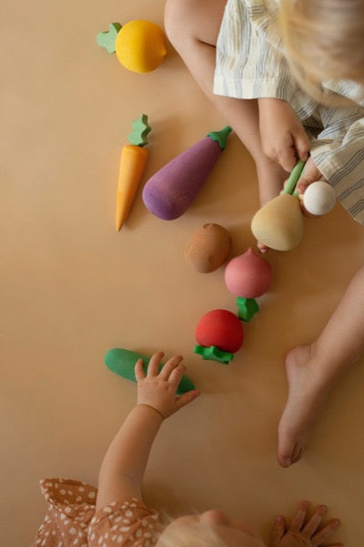 Kids playing Wooden Vegetables Set