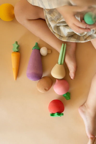 Child playing with Wooden Vegetables Play Set