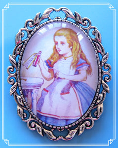Alice with drink me bottle brooch is an illustration by John Tenniel for the original Alice in Wonderland books.