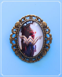 Diana of Themyscira - WW mini brooch/necklace single.  The setting has a loop soldered to the back so wear as a necklace or brooch!