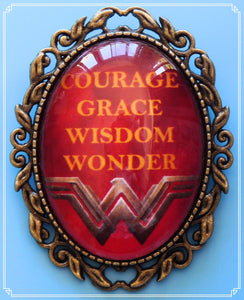 Inspired by the new Wonder Woman movie I designed this brooch on a fiery red background incorporating the Wonder Woman symbol & Courage, Grace, Wisdom, Wonder.