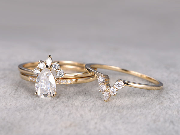 Moissanite engagement ring set 5x8mm pear cut main stone 14k yellow gold moissanite matching bands