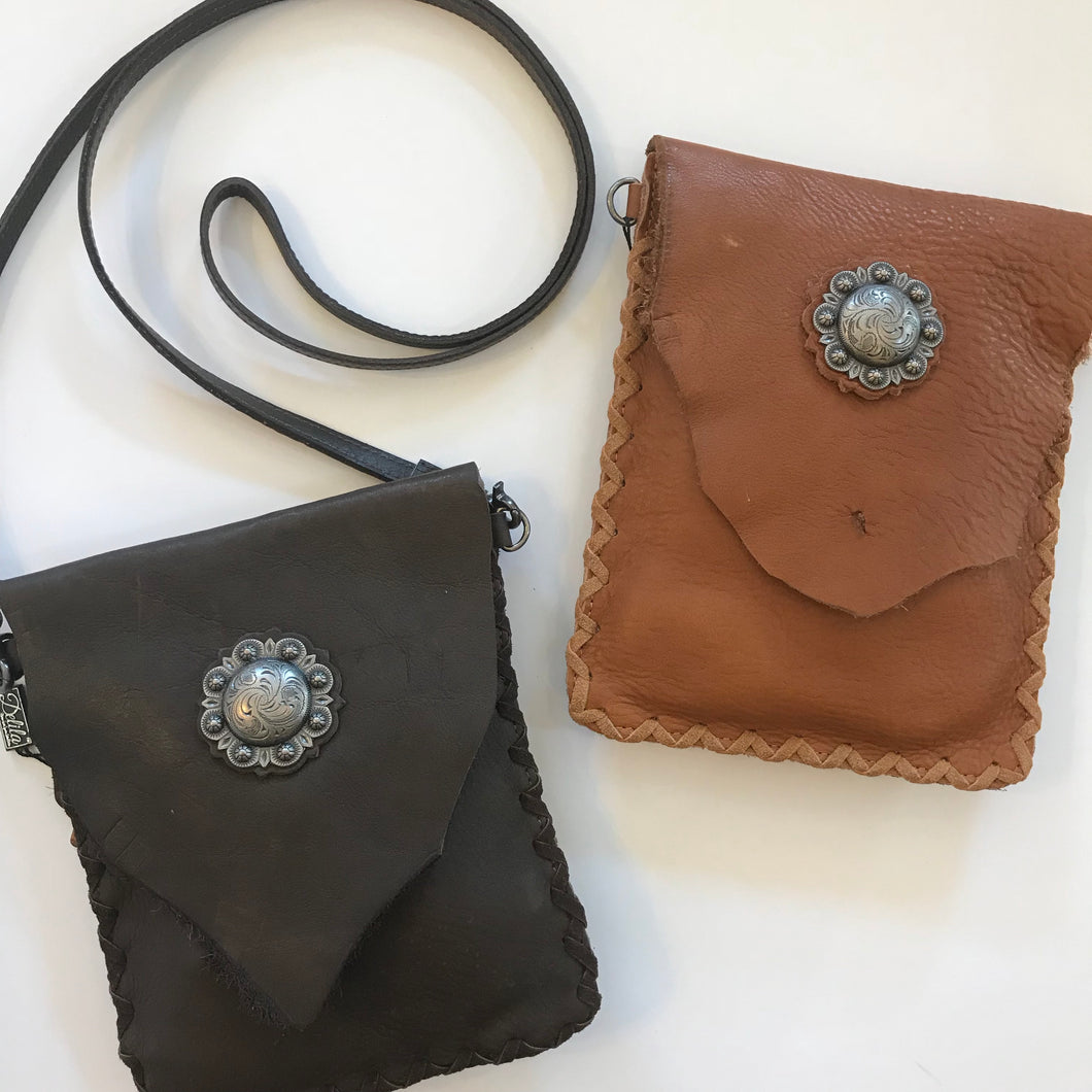 Delila 100% genuine leather crossbody. Concho on flap with magnetic closure