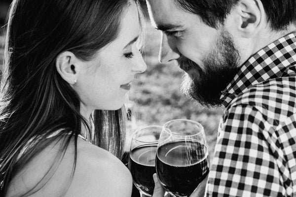 woman giving man wine gift
