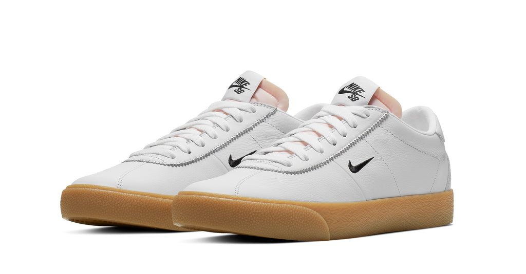 nike sb orange label bruin shoes, white leather, black nike swoosh, gum sole, white background