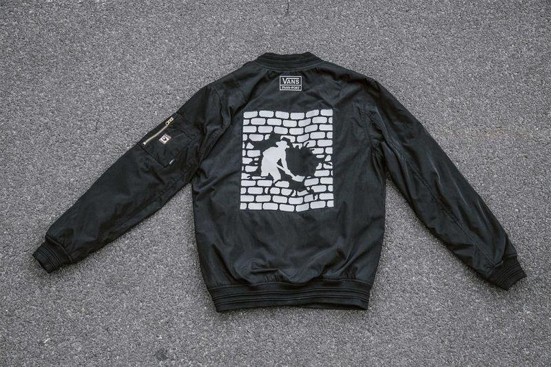 black vans passport bomber jacket, digging man graphic print in the back, cement background