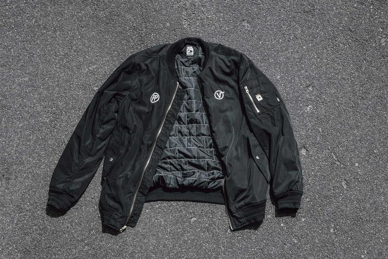 black bomber jacket, vans, pass~port, cement background