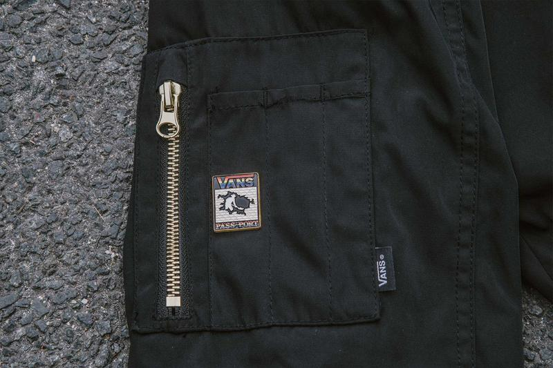 bomber jacket side pocket, vans pass port logo, enamel pin, close up view