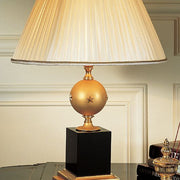 Black marble and gold table light with gold enamelled sphere